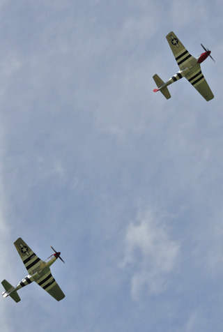 Mustang Winter Turf >> The two B-25 Mitchell's, left, and two of the P-51 Mustang's, right, in flypasts for the crowd.